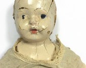 Creepy composition and sawdust doll in original clothes haunted decrepit condition