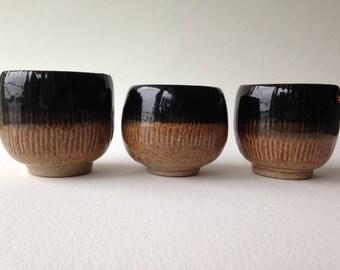 Three Black and Nutmeg Stoneware Tea Bowls