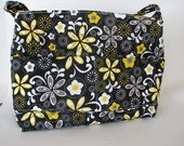 Black and yellow flowered purse with zipper