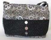 Shinney silver with black swirls purse