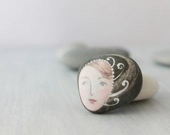 Painted stone. painted pebble. Beach pebbles art