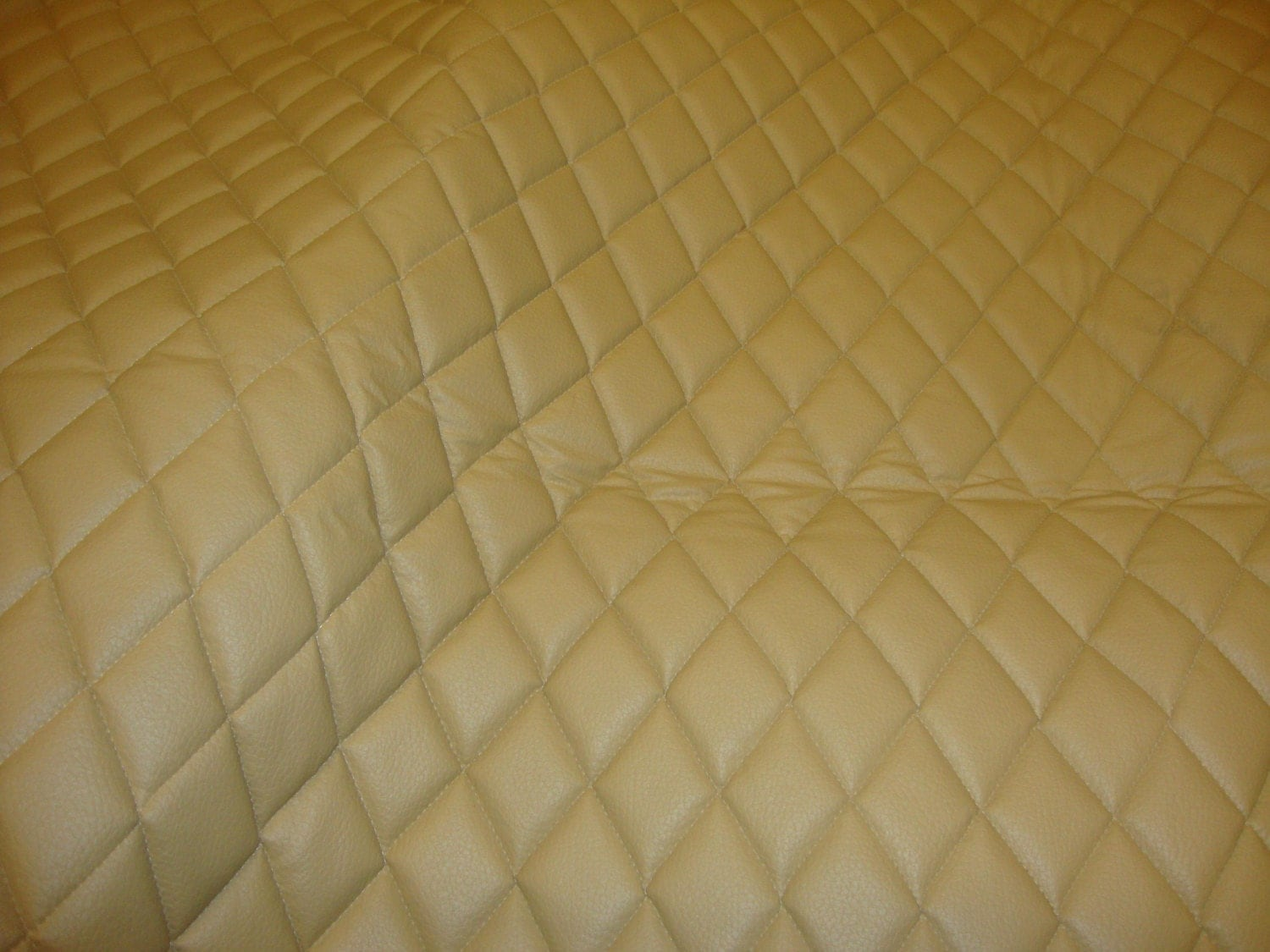 camel quilted vinyl fabric with 3 8 foam backing. Black Bedroom Furniture Sets. Home Design Ideas