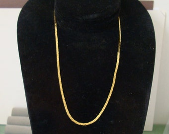 NECKLACE, hangs 8 inch , marked KRAMER on tag. this is a goldtone link type neck. condition  i s NEAR new