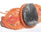 Macrame bracelet with natural quartz gem, orange, pink and yellow tones