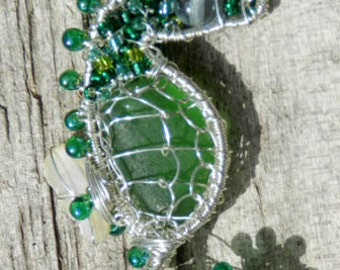 Green seahorse wire wrapped beach glass pendant