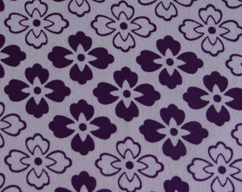 Japanese kimono fabric featuring violet coloured flower pattern.