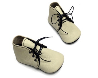 Baby shoes.  Handmade leather baby booties.  Cream and black infant shoes.