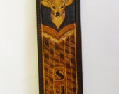 Deer embossed leather rifle sling.
