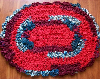 Oval Rag rug red and blue.  Hand crocheted  rug South Dakota made.