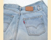Vintage 1980s jeans, Levi 501 red tab button fly, waist 31 inches, inside leg 31 inches