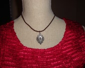 Necklace with faux leather braid and antique silver tone pendant (s&h incl)