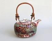 red green teal unique teapot with wooden handle