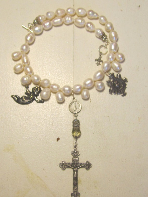 reserved for Anne custom pearl necklace with silver vintage crucifix, cupid, and shield by atelier paris on etsy