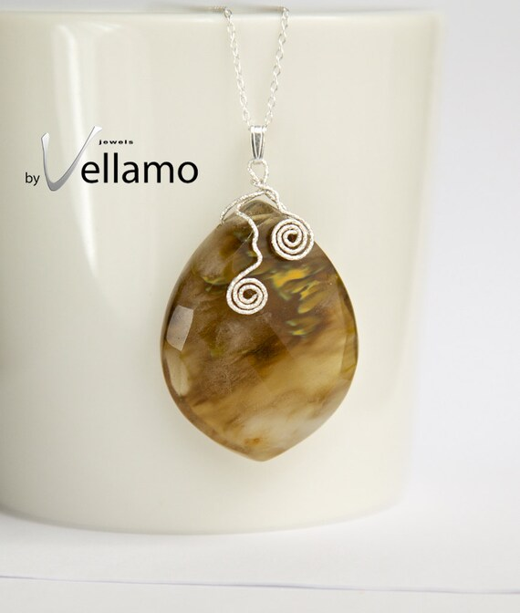 One of a kind pendant with faceted volcano cherry quartz gemstone, spiral silver wire shapes, golden brown sterling pendant