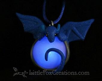 Glowing Water Dragon Amulet