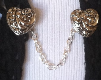 The mattie silver tone bow heart sweater clip is the pretty finishing touch to any outfit.
