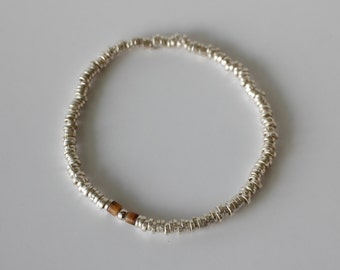 Silver beads bracelet feathering a marasite bead in center.
