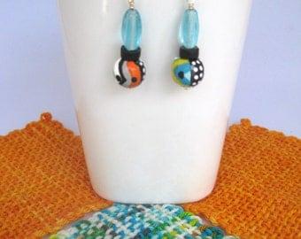 Hand painted earrings, dangle earrings, teal earrings, spots and stripes