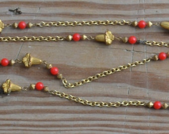 Gorgeous antique art deco flapper style necklace with gold flower beads and coral red glass