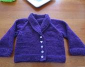 Hand knit little girl's bright purple shawl collar cardigan