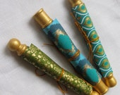 Scrolls of turquoise, green and gold. Roll up a love note, poem, gift certificate or money.