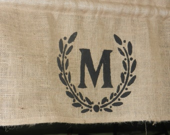 Burlap wreath stencil valance with initial in center of wreath.