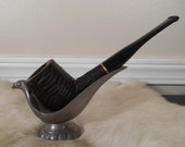 AF - This is a vintage Cary Magic Inch tobacco pipe