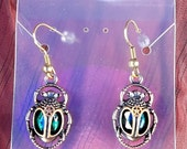 Clockpunk Steampunk Earrings, Brass Scarab Beetles with Emerald Gems on French Hooks