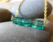Glass cube pendant.