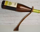 Wave 75, an espresso mahogany wood gravity wine bottle holder, recycled wood wine display,