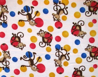 Monkeys flannel fabric monkeys play on red blue yellow balls - YARD