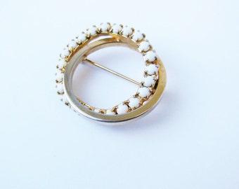 Lisa Circular Brooch Pin with white stones.