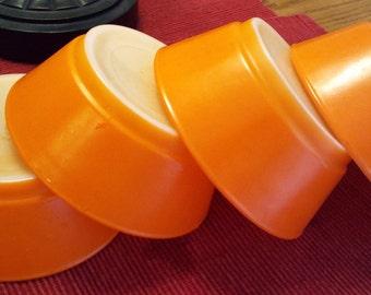 Four Orange Anchor Hocking Oven-Proof bowls
