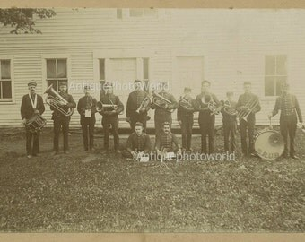 Wind music band with instruments outdoors antique photo
