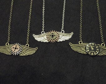 Steampunk style wing pendants with gears or watch face