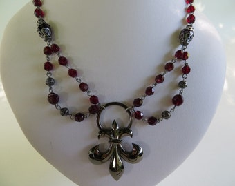 Victorian gothic necklace with fleur de lys and dark red garnet crystals