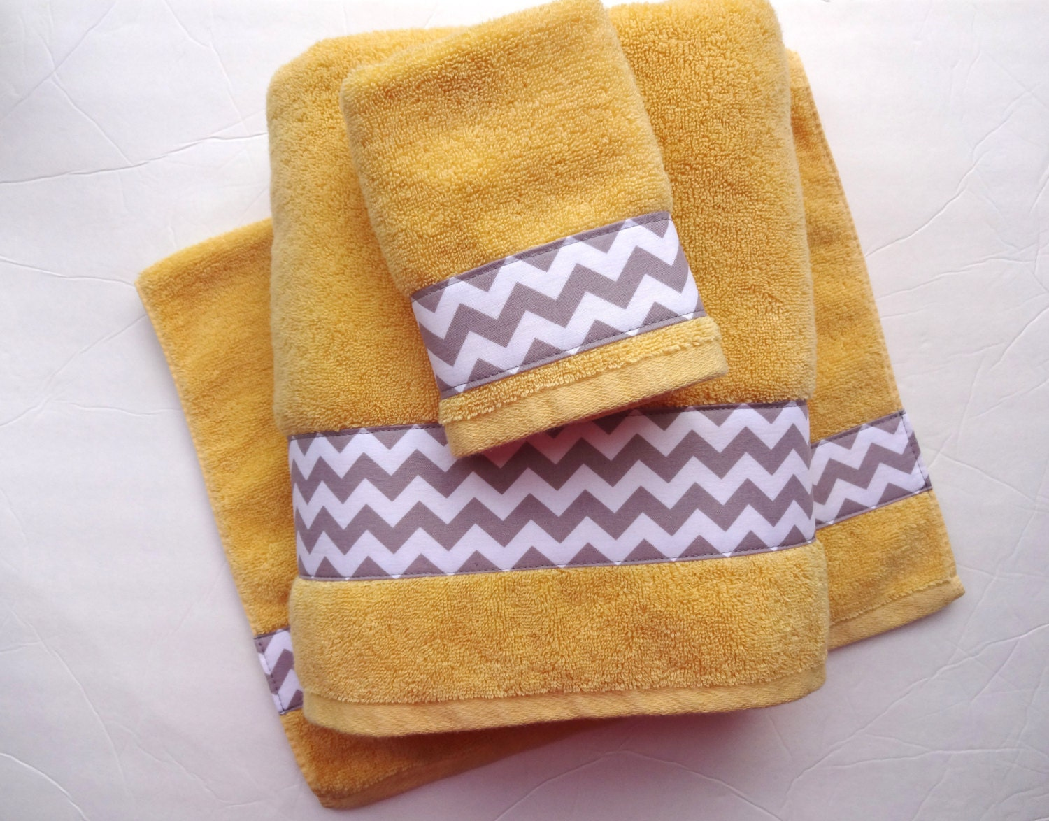 You pick size towel yellow and grey towels gray and yellow