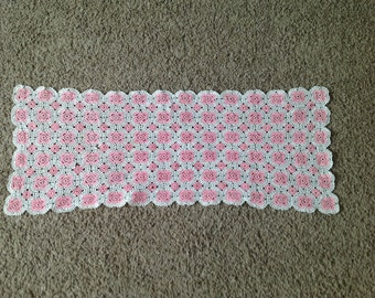 Pink and white embroidered runner