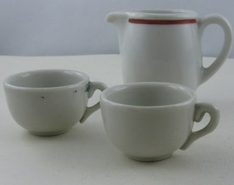 20% OFF. Convolute dishes for dolls: 1 creamer (Alt-Schoenwald 391) and 2 cups of porcelain. Made in Germany. Vintage
