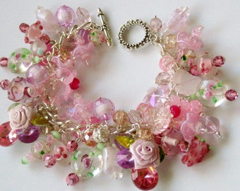 Pretty in pink loaded spring cha cha charm bracelet