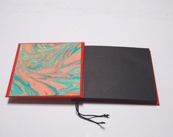 Red cotton cloth, black recycled paper photo album with hand marbeized endpapers
