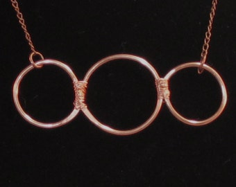 Gorgeous piece!  Tri-rings, attached with wire wrap.  - delicate!  choose gold, silver, copper