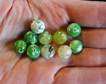 10 natural fire agate beads, light green with variations of lighter color, no bead is the same, 10 mm, hole 1 mm , round and faceted