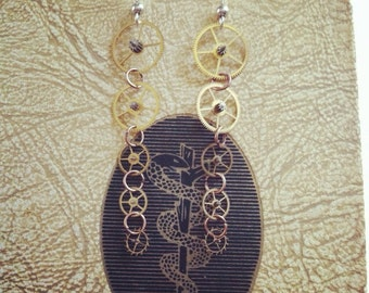 Steampunk dangle gear earrings made with real vintage brass gears