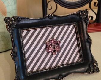 Jeweled brooch frame art
