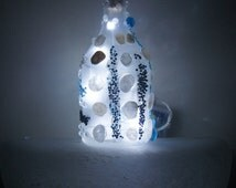 Frosted Patron bottle light - LED lights are battery operated - features gemstones & sea stones