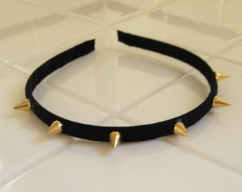 Black headband with gold spikes