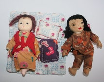 Two Old Vintage Oriental Dolls - One Made In Japan - With Mat And Cushions.