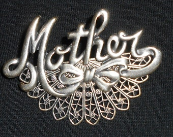 Loving silver Mother pin.