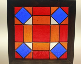 Wood framed quilt block stained glass panel